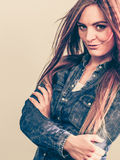 Confident young lady with long hair. Royalty Free Stock Image