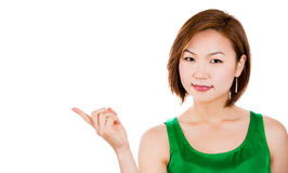 Confident young lady pointing at a copy space Stock Photography