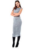 Confident young lady in trendy outfit. Fashionable young female posing with confidence Stock Photos