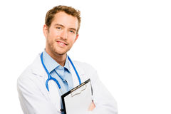 Confident young male doctor holding clipboard on white backgroun Royalty Free Stock Images