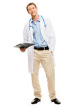 Confident young male doctor holding clipboard on white backgroun Royalty Free Stock Photography