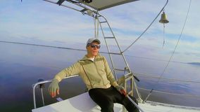Confident young male having rest on sailing yacht open sea. Stock footage stock video