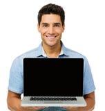 Confident Young Man Advertising Laptop Stock Photos