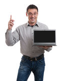 Confident young man advertising laptop Stock Image