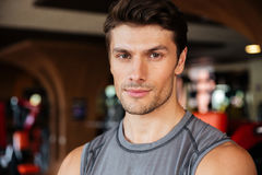 Confident young man athlete in fitness club Stock Image