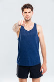 Confident young man athlete standing and pointing on you Royalty Free Stock Images