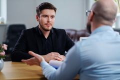 Confident young man attending job interview. Confident men attending job interview royalty free stock photography