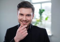 Confident young man attending job interview. Confident man attending job interview royalty free stock photography