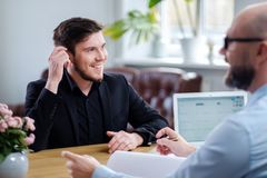 Confident young man attending job interview. Confident men attending job interview royalty free stock photo