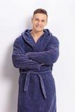 Confident young man in a blue bathrobe Stock Photography