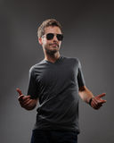 Confident young man in dark glasses Stock Photo