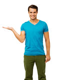 Confident Young Man Displaying Invisible Product Stock Image
