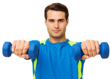 Confident Young Man Exercising With Dumbbells Royalty Free Stock Photo
