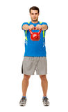 Confident Young Man Exercising With Kettle Bell Stock Image