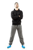 Confident young man with folded hands in the sportswear. Confident young man with folded or crossed hands in the sportswear. Full body length isolated over white Stock Image