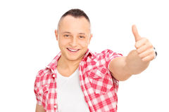 Confident young man giving a thumb up Stock Photography