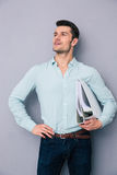Confident young man holding folders Royalty Free Stock Photo