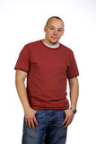Confident Young Man Leaning Forward Royalty Free Stock Image