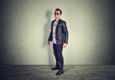 Confident young man looking at you camera standing royalty free stock photos