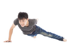 Confident young man make push-ups by single hand Royalty Free Stock Images