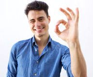 Confident young man with ok hand sign Stock Images