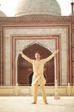 Confident young man with open arms wearing kurta Stock Photo