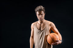 Confident young man playing basketball Royalty Free Stock Images