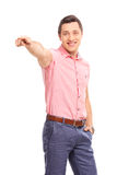 Confident young man pointing forward with his hand Stock Photos