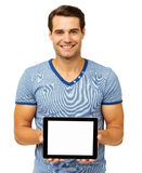 Confident Young Man Showing Digital Tablet Stock Photo