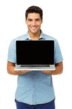 Confident Young Man Showing Laptop Royalty Free Stock Photo
