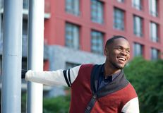 Confident young man smiling outdoors Stock Image
