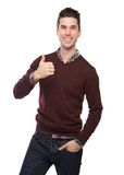 Confident young man smiling with thumbs up sign Royalty Free Stock Photo