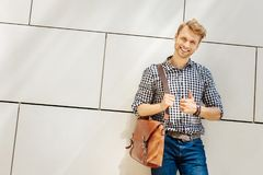 Confident young man smiling to you stock image