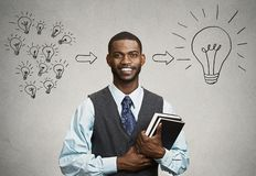 Confident young man, student holding books has big ideas Royalty Free Stock Photos