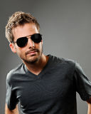Confident young man in sun glasses Stock Images