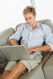 A confident young man working on a laptop Royalty Free Stock Image
