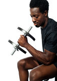 Confident young man working out Stock Photos
