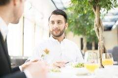 Discussion in restaurant Royalty Free Stock Image
