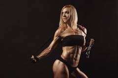 Confident young muscular fitness female Royalty Free Stock Photography