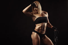 Confident young muscular fitness female Royalty Free Stock Images
