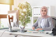 Muslim woman worker working on personal studio