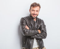 Confident young sexy man in leather jacket Stock Photos