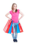Confident young shopper holding shopping bags in her hands Stock Image