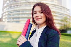 Confident young smiling student outdoors royalty free stock photography