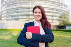 Confident young smiling student outdoors stock photos