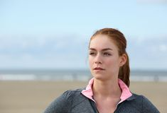 Confident young sports woman standing outdoors Stock Photo