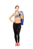 Confident young sporty woman holding towel over shoulder Royalty Free Stock Photos