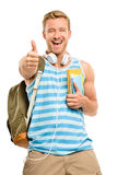 Confident young student thumbs up sign on white background Stock Image