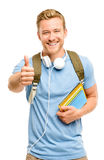 Confident young student thumbs up sign on white background Royalty Free Stock Photography