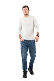 Confident young stylish man walking towards camera leisurely Royalty Free Stock Images